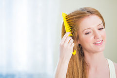 Young beautiful woman with long well maintained hair Royalty Free Stock Images
