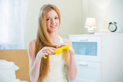 Young beautiful woman with long well maintained hair Stock Photography
