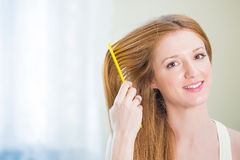 Young beautiful woman with long well maintained hair Stock Images