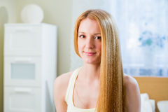 Young beautiful woman with long well maintained hair Stock Photos