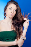 Young Beautiful woman looking at her split hair Stock Photography