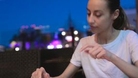 Young beautiful woman looking at menu in restaurant and making order for dinner lunch event dating stock footage