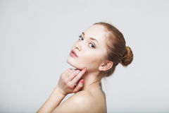 Young beautiful woman. Looking, naked shoulder Royalty Free Stock Photography