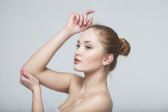 Young beautiful woman. Looking, naked shoulder Stock Image