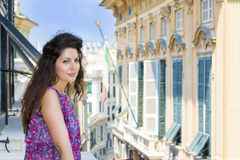 Young Beautiful woman looking over balcony in the city of Genova,Italy Royalty Free Stock Image