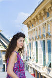 Young Beautiful woman looking over balcony in the city of Genova,Italy Royalty Free Stock Photos