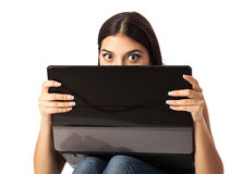 Young beautiful woman looking over a laptop Royalty Free Stock Photos