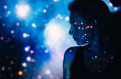 Young beautiful woman lost  in space around stars Royalty Free Stock Image