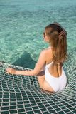 Young woman lounging in a hammock. Stock Images