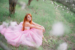 Young beautiful woman in the lush garden. Young beautiful woman in the lush spring garden Royalty Free Stock Photos