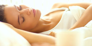 Young beautiful woman lying in bed Stock Photo
