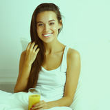 Young beautiful woman lying in bed Royalty Free Stock Image