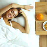 Young beautiful woman lying in bed Royalty Free Stock Photo