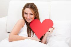 Young Beautiful Woman Lying On Bed Royalty Free Stock Photo