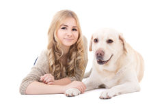 Young beautiful woman lying with dog isolated on white Royalty Free Stock Photo