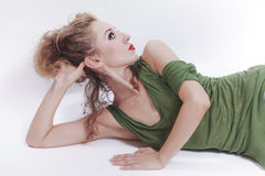 Young beautiful woman lying on the floor Stock Images