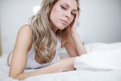 A young beautiful woman is lying in her bed. royalty free stock photo