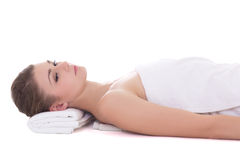 Young beautiful woman lying on a massage table isolated on white Stock Photography