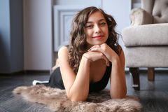 Young beautiful woman lying on polished floor in studio stock photos
