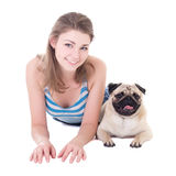 Young beautiful woman lying with pug dog isolated on white Stock Images