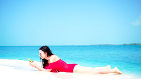 Young beautiful woman lying at shallow tropical water stock footage