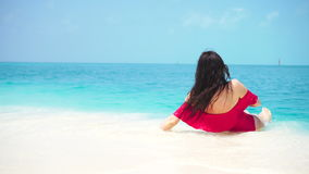 Young beautiful woman lying at shallow tropical water stock video
