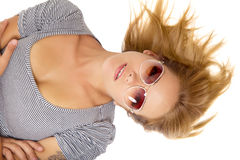 Young beautiful woman lying in sunglasses Royalty Free Stock Images