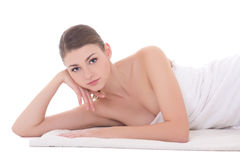 Young beautiful woman lying on towel isolated on white Royalty Free Stock Photos