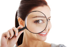 Young beautiful woman with magnifying glass. Stock Photo