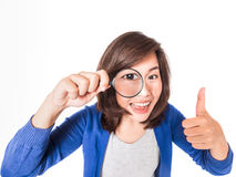 Young beautiful woman with magnifying glass. Stock Images
