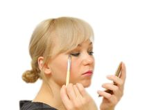 Young beautiful woman with a make-up brush Stock Image
