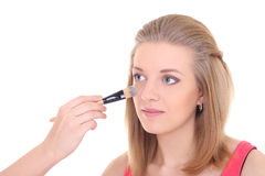 Young beautiful woman with make-up brush over white Royalty Free Stock Images