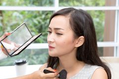 Young beautiful woman with Make Up Brush. royalty free stock photography