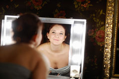 Young beautiful woman at a make-up studio Royalty Free Stock Photos