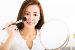 Young beautiful woman with Makeup Brush Stock Image