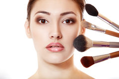 Young beautiful woman with makeup brushes Stock Photo