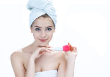 Young beautiful woman with makeup brushes near her face royalty free stock photo