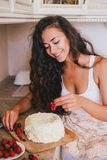Young beautiful woman making cake at the kitchen Royalty Free Stock Image