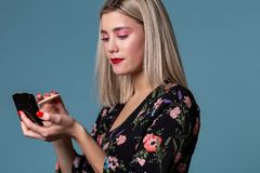 Young beautiful woman making make up with face powder royalty free stock photos