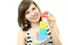 Young beautiful woman making a toy house Stock Photos