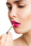 Applying lipstick brush Royalty Free Stock Photo