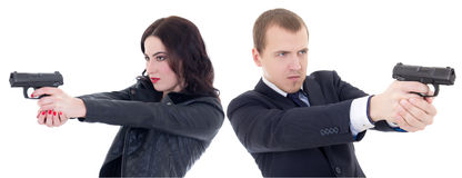 Young beautiful woman and man shooting with guns isolated on whi Stock Photos
