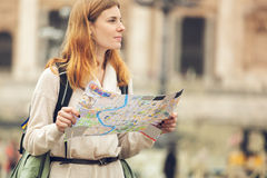 Young beautiful woman with map. Royalty Free Stock Photography