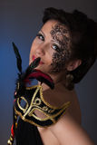 Young beautiful woman with mask. Royalty Free Stock Image