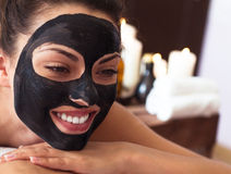 Young beautiful woman in a mask for the face of the therapeutic Stock Image
