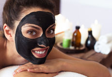Young beautiful woman in a mask for the face of the therapeutic Royalty Free Stock Photos
