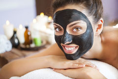 Young beautiful woman in a mask for the face of the therapeutic Stock Photo