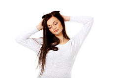 Young beautiful woman massaging her own hairs Stock Photography