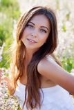 Young beautiful woman on the meadow Royalty Free Stock Photography
