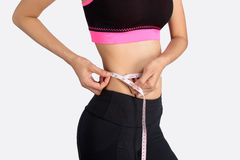 Young beautiful woman measuring her waist. royalty free stock photo